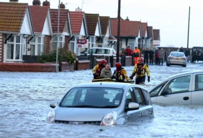 Gale force winds batter Europe, as thousands in U.K. face more flooding